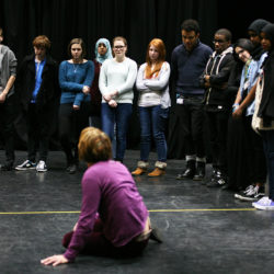 teaching students on stage